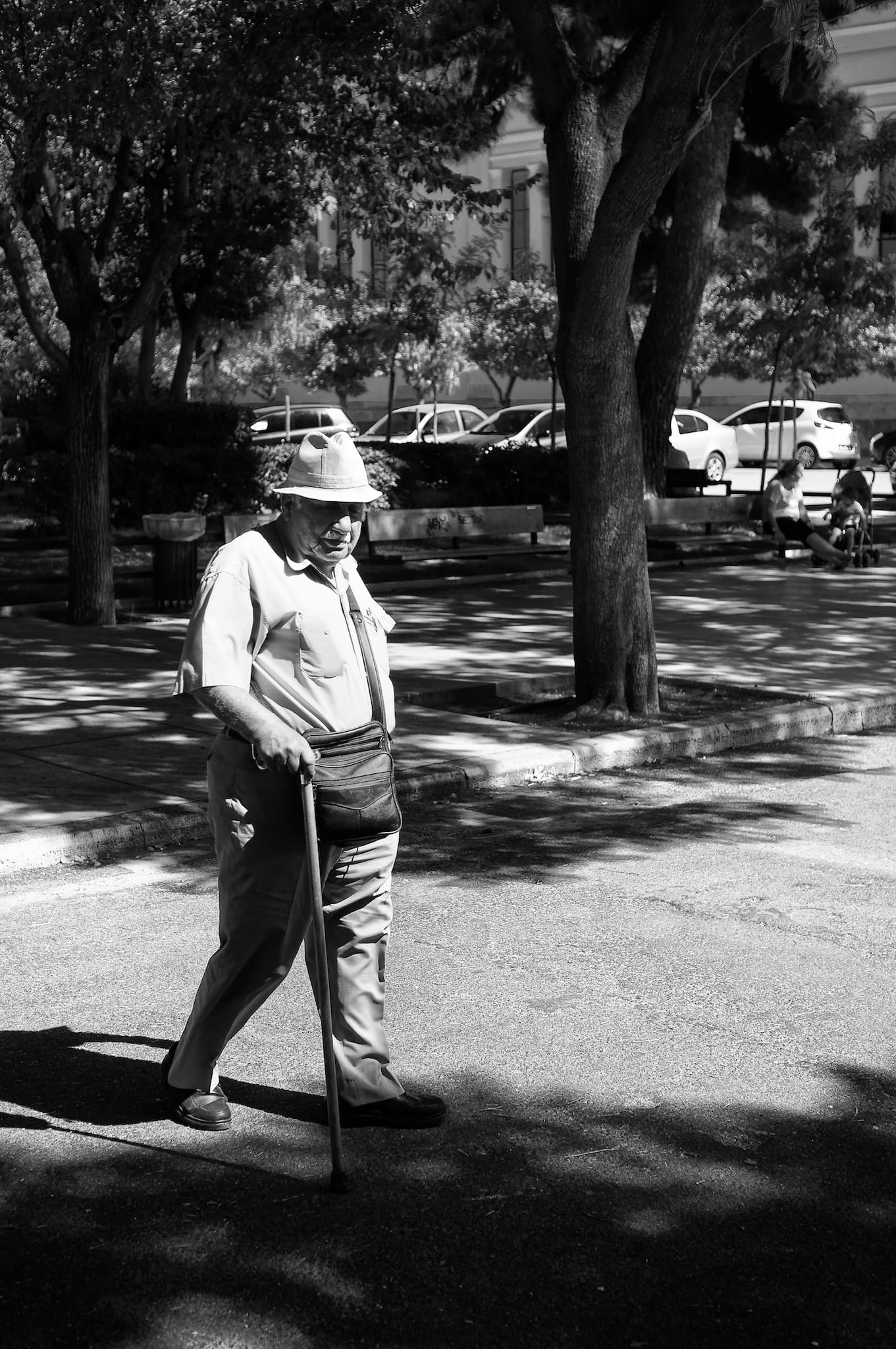 Man in a hat and a walking stick