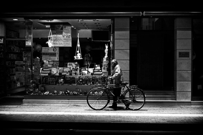 old-man-walking-his-bicycle