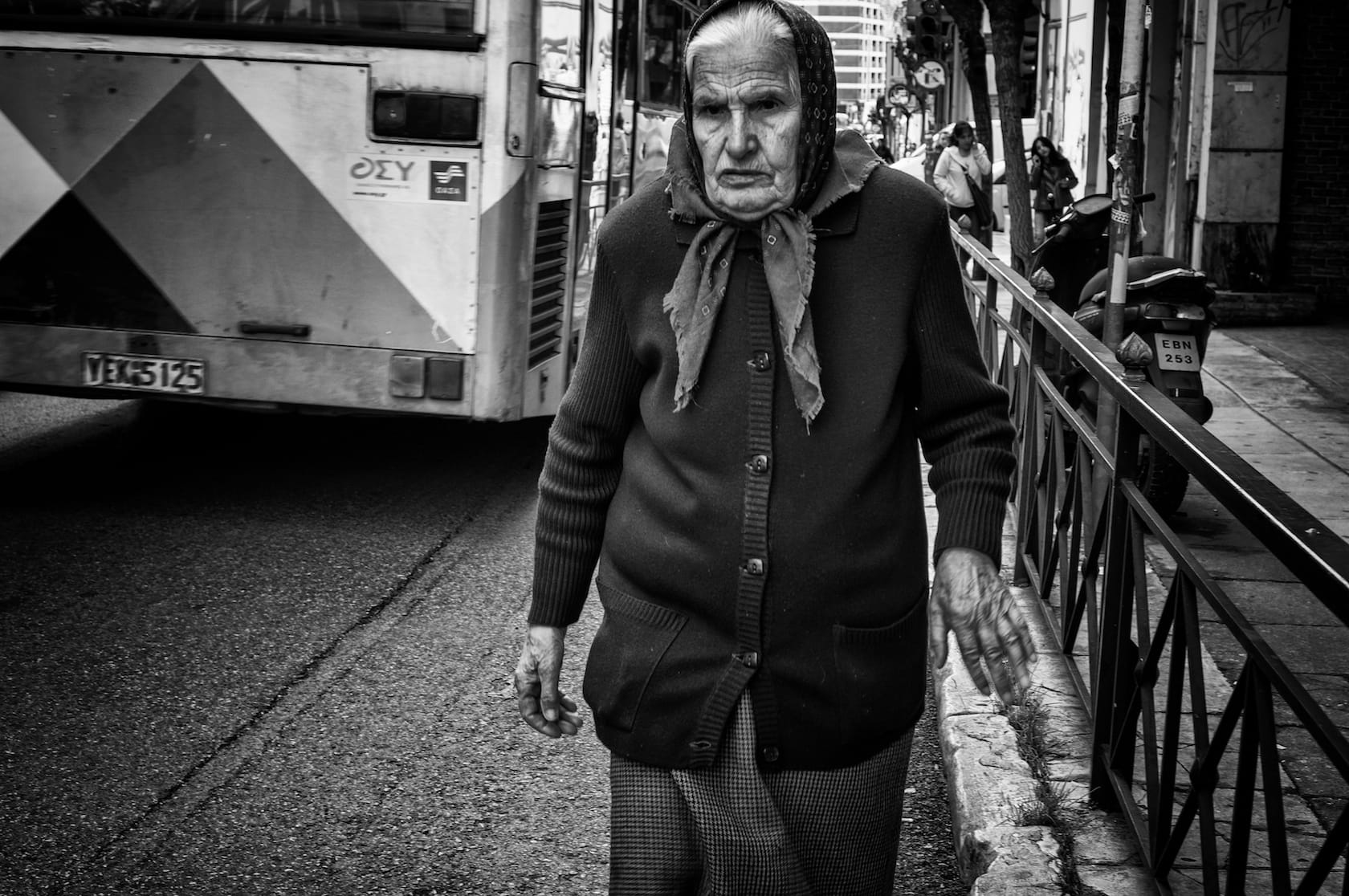 Old lady walking in the street