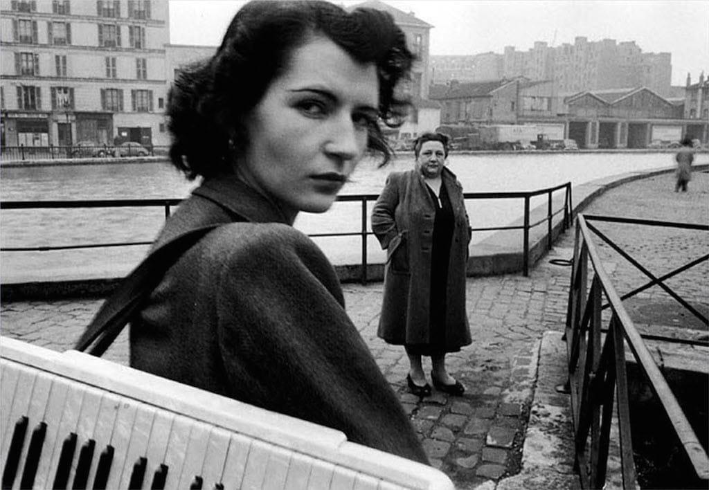 Accordion girl by Robert Doisneau