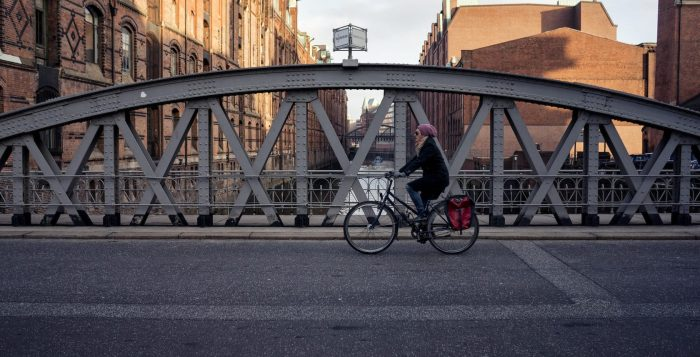 Cyclist riding over a Bridge in Hamburg