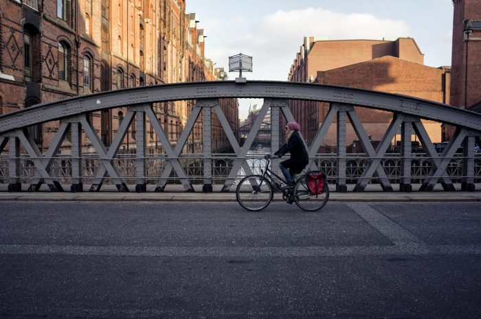 Cyclist riding over a Bridge in Hamburg
