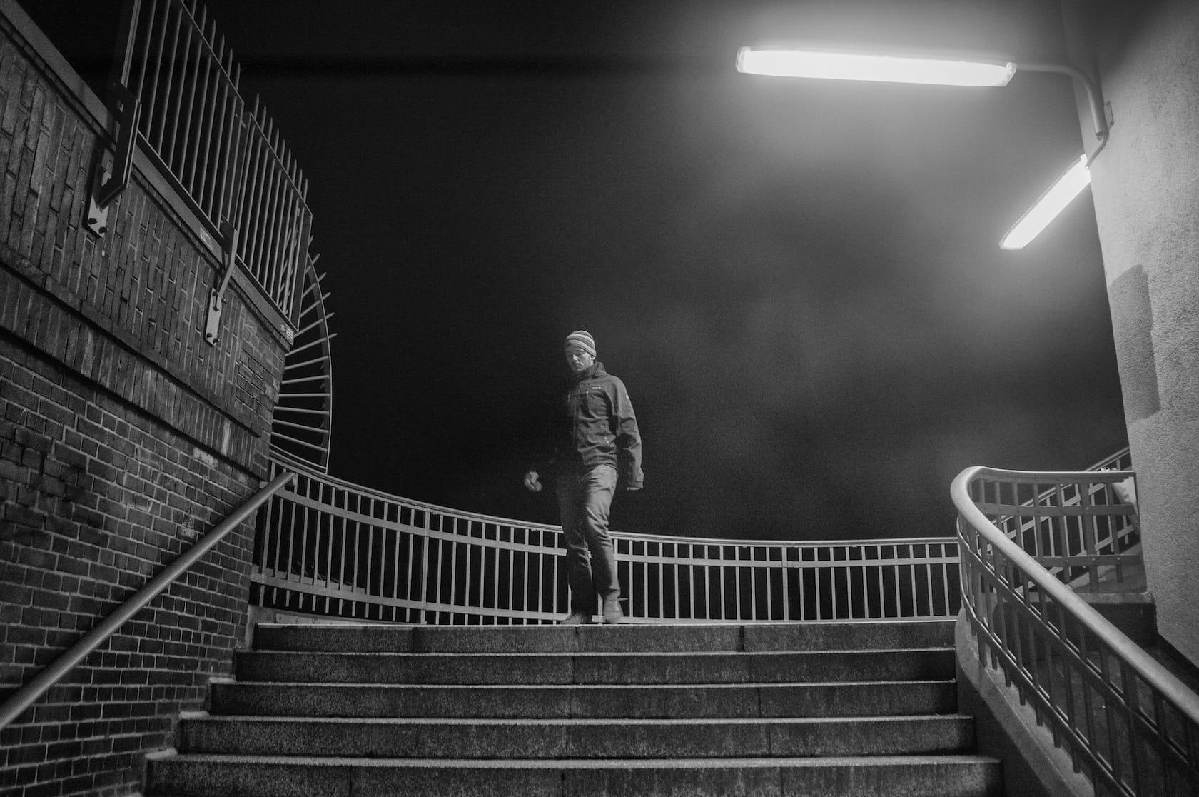 Man climbing down stairs