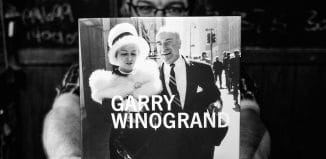 "Andrew Sweigart holding the book ""Garry WInogrand"""