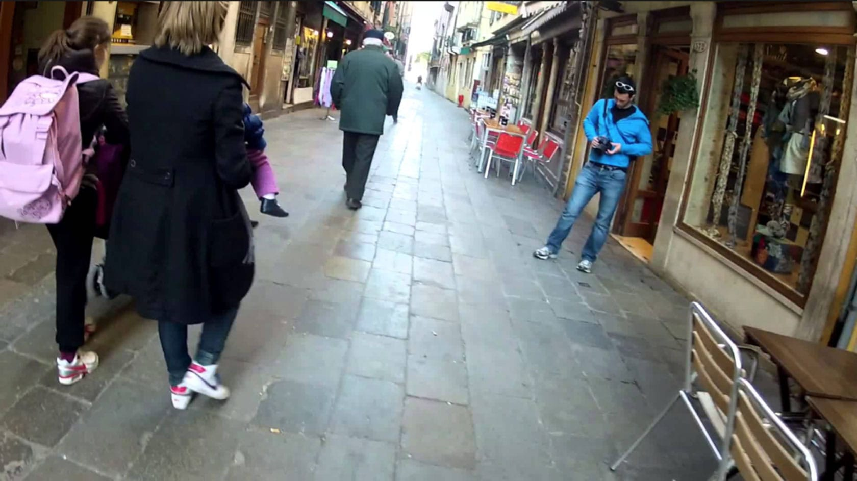 A still of a street scene from a POV street phtotography vlog video recorded with an action camera